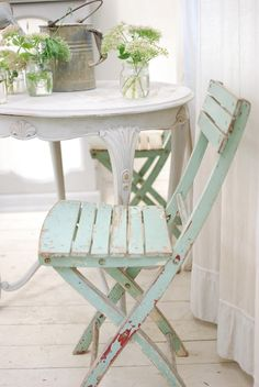 Well loved chair in pale green.
