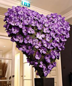 This is kinda neat! purple orchid heart arrangement - a real eye-catcher for a wedding reception.