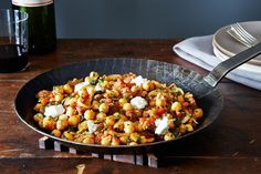 Dinner Tonight: A Warm Pan of Chickpeas, Chorizo, and Chèvre on Food52--use veg chorizo--served with egg and sliced avocado--next time mix mashed avocado and yogurt and lose the cheese