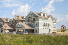 ISLAND OASIS, #832 l Nags Head, NC - Outer Banks Wedding and Event Home l Newly constructed in 2014, this oceanfront retreat provides 8 master suites, elevator, theater lounge, recreation lounge, heated pool, hot tub, poolside bar and grill area, cabana bath, private beach walkway and dune-top gazebo. l www.CarolinaDesigns.com