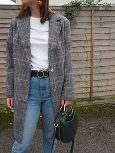 Statement earrings, belt and bag paired with simple Mom jeans and a checked coat. Perfect outfit for Fall | Hannah and The Blog