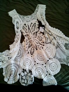 """createcreatively: """" Old doilies pieced together into a vest. So delicate and still modern, with the asymmetrical design. Made by Marijo Brown with her Home Chic Home collection. """""""