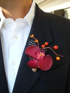 red orchid boutonniere