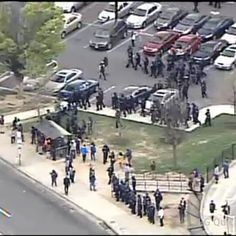 "Baltimore ""Cops in Body Armor for H.S. STUDENTS"" When school let out police were in the area equipped with full riot gear; were stopping busses and forcing riders, including many students who were trying to get home, to disembark. Cops shut down the local subway stop. They also blockaded roads near High School, which is across the street from the mall, and essentially corralled young people in the area. That is, they did not allow the after-school crowd to disperse."