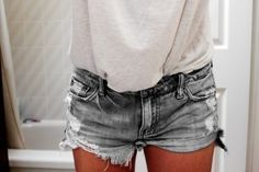 Distressed gray cutoffs.