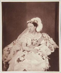 Queen Victoria in her Drawing Room Dress, photographed 11th May 1854 (this is an 1893 copy of that photograph).