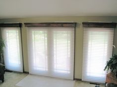 """Handmade, wooden cornices with """"Window Shadings"""", a great alternative to Silhouettes. The cornice boards were made to cover the headrails of the shades."""