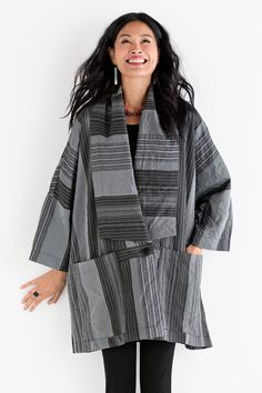 Haiku Jacket by Heydari. Kimono inspiration and menswear-style stripes may seem worlds apart, yet they come together perfectly in this dramatic statement piece. Its exaggerated collar and wide sleeves create a big, bold silhouette that pairs especially well with slim pants. Overview: Long sleeves Above knee length Single button closure Generous front pockets Artist-made in the U.S.A. Fabric & Care: 100% polyester Machine wash cold, dry flat Fit & Sizing: Oversized fit: full, generous, and…