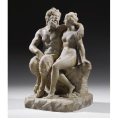 A MARBLE GROUP OF THE GOD PAN WITH A NYMPH  , ROMAN IMPERIAL, CIRCA 1ST CENTURY A.D.
