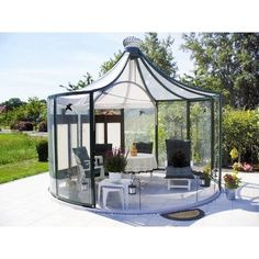 Add a sanctuary to your outdoor environment with the stylish versatility of the Exaco Rondo Garden Pavilion . This beautiful enclosure showcases a peaked. Wood Pergola, Patio Gazebo, Backyard, Garden Structures, Outdoor Structures, Permanent Gazebo, Outdoor Spaces, Outdoor Living, Hardtop Gazebo