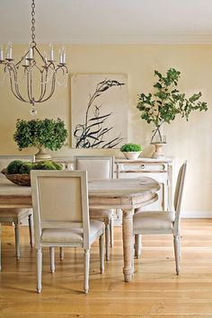 Paint all dining room pieces lighter color - chandelier looks similar to yours :)