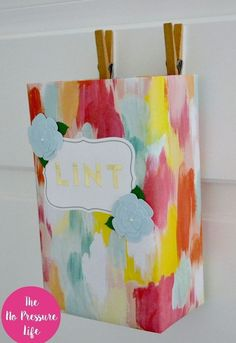 make a cute and free laundry room lint bin