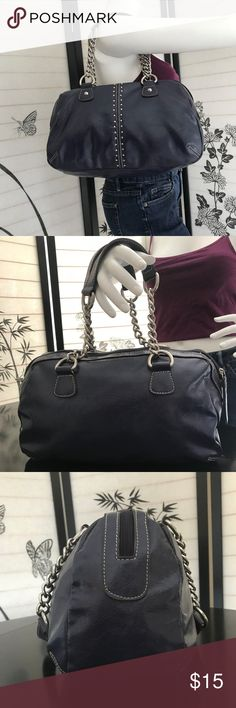 """Nine West Faux Leather Dark Purple Purse The color & style of this Nine West shoulder bag is what caught my attention. The color is unique; it is a dark purple, yet sometimes can appear navy. It is in great condition. On the left side of the bag there is minor signs of wear. I included a photo & as you can see I used a pins point to point it out. The white lining is pristine.   Exterior Material: Man-made  Interior Lining: Polyester Dimensions: L:13.5"""" x H:9"""" xD: 4.5"""" Strap: 17""""  Interior…"""