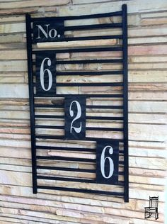 For the front of the house.  Crib rail painted and used to display House Numbers could also add a couple flower pots or wreath.