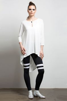 Converge Cocoon Tunic from Nesh NYC. High-low hem tunic with a keyhole neckline adds a feminine edge to this look. Colors: White and Black