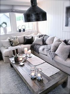 Living inspiration.Love the pillows and the wooden coffee table
