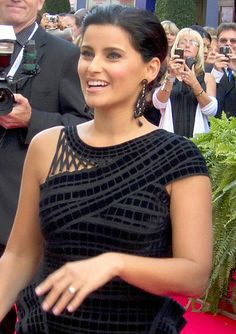 """Nelly Kim Furtado (born December 2, 1978) is a Canadian singer, songwriter and actress. She has sold 20 million albums worldwide and more than 20 million singles, bringing her total sales to over 40 million records around the world. Furtado first gained fame with her debut album, Whoa, Nelly!, which spawned two successful singles, """"I'm Like a Bird"""" and """"Turn Off the Light"""". """"I'm Like A Bird"""" won a 2001 Juno Award for Single of the Year and a 2002 Grammy Award for Best . . ."""