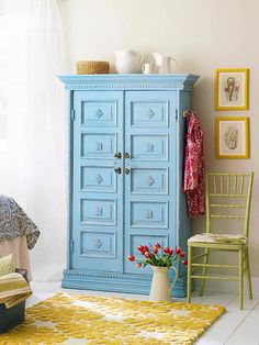 Tired to Revived Hutch....Layers of molding along the top and bottom add presence to the simple cabinet, as does bold sky blue paint. Rope molding outlines the doors, and the panels are accented with pretty medallions. The embellishments were rubbed with a decorating glaze to give the color depth.