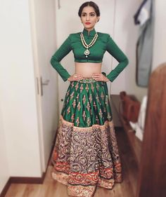 Sonaam Kapoor In Estee Couture Emerald Green #Lehenga With Red & Purple Embroidered Border.