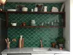 I noticed that these tiles usually work well with wood accents (shelves) but the gray marble counter is represented, just wish we could see how it works with silver.