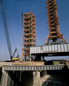 CAPE CANAVERAL, Fla. -- At the Kennedy Space Center in Florida, the shuttle service and access tower SSAT, left, is assembled at Launch Complex 39A from sections of launch umbilical tower 3.