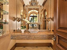 Love the overlayed mirrors and rich gold for the powder bath.