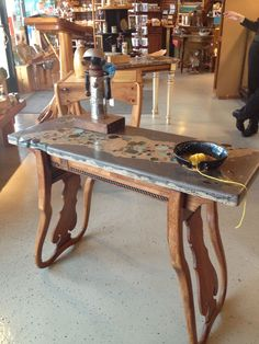 This cool table is in an art gallery in Boyne City, MI.  Like the use of chair backs. #ChairRepurposed