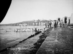 National Library of Ireland on The Commons The Bathing Slip at Tramore in Co. And what a remarkable range of early century male swimwear. Some seem almost improvised Date: Circa 1910 Source by swimwear Paris Skyline, New York Skyline, Bikini Photos, Historical Photos, Male Swimwear, Bathing, Ireland, Photoshoot, Range