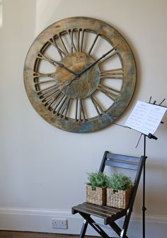 """The most unique handmade modern skeleton wall clock - """"Summer Storm"""".It is a member of the new family of hollow clocks. The clock face is displaying carefully hand crafted Roman Numerals on a wooden frame and you can see the wall between the numbers. With a total diameter of 100 cm and its unique contemporary design, the Summer Storm will look fantastic in all interiors."""