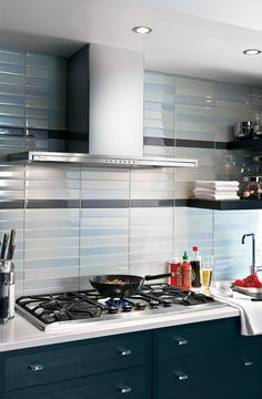 Another idea for backsplash with light blue glass tiles