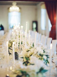 an all white tablescape loaded with taper candles. so romantic #candlelight #tablescape #white Photography by jessicalorren.com  Read more - http://www.stylemepretty.com/2011/11/22/english-barn-wedding-by-marianne-taylor-photography-mark-brown/