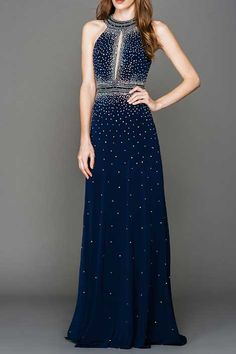 Evening Gown AC250 Floor Length Evening Prom Dress with Rhinestone Embellished Bodice featuirng Front Keyhole Detail and High Neck, Decorated Back with Cutout and Invisible Zipper Closure, Solid Color Skirt. https://www.smcfashion.com/wholesale-evening-dresses/evening-gown-ac250