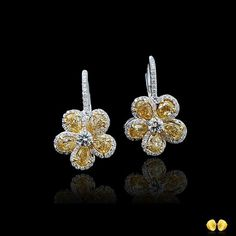 Classic #NovelCollection flower motif earrings, fancy yellow diamonds with white center stones