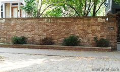 brick fence with decorative elements: brick fence designs