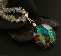 Gorgeous Dichroic Pendant in  Rust and Green with a Handmade Beaded Cord. - $89.21 USD