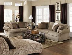 taupe sofa with navy/ivory rug | living room theme | pinterest