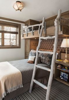 Ladder and railing on the bunk bed give the bedroom a cool touch [Design: Meadow Mountain Homes]