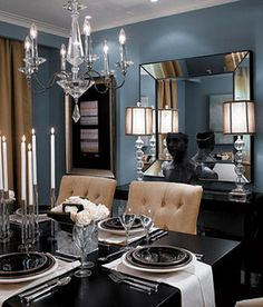 Formal blue-gray dining room. I adore the colors in this room.  The dark tables and dark dinnerware softened by the white roses, candlesticks and off-white napkins.