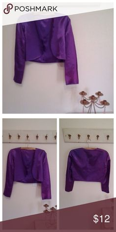 Satin long Sleeve Bolero, Purple size large Bolero or crop Jacket Long Sleeves Rounded Satin Feel  The color is iridescent and different shades  Perfect over an evening dress for a wedding or social event  No labels    38 bust  Good condition Jackets & Coats