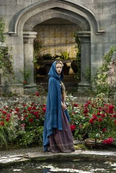 """Anna in her garden. """"I saw her there that night, like she always did. I should have known something was wrong. She had her hood up and a sad look on her face. But when she caught me looking from the door she gave a smile and wave. I waved back to her and headed back inside. I had no idea it would be the last time I would see her"""""""
