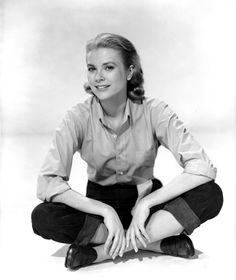 Borrowing from the Boys: Grace Kelly in a pink button-down shirt and skinny pants, 1954.