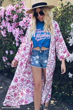 A longline satin kimono featuring an ornate floral print, open front, dropped shoulders, 3/4 kimono sleeves, and high side slits.