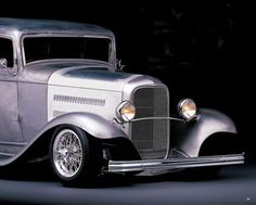 Eric Clapton's 1932 Ford Victoria dressed in Borrani Wheels!