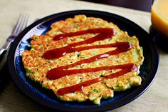 Okonomiyaki, a savory Japanese pancake.  I've had one and it was absolutely delicious.  (But I haven't made one, much less this particular recipe, so I can't vouch for it.)