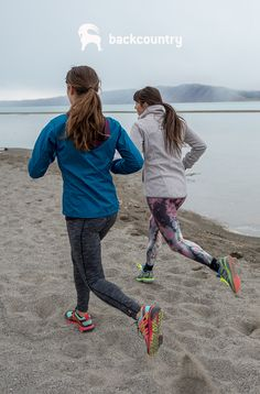 """Highway 89 wraps around the western edge of Bear Lake. Famous for its turquoise color, the lake is sometimes called the """"Caribbean of the Rockies."""" Gray skies dull the color, but Lexi and Chelsea still take the opportunity to go for a run."""