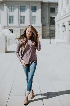 That purple sweater is perfect for colder fall days and winter! I love it paired with the rolled cuff jeans and booties.