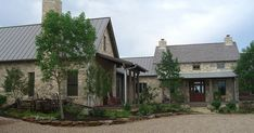 Fredericksburg, Texas Cottage - Stone farmhouse with lovely front porch - By: Bonterra Building & Design - Metal roof - Live oak tree. Description from pinterest.com. I searched for this on bing.com/images