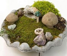 Missing the stand to a birdbath?  Well, don't throw that remaining part away!  Give it new life as a spectacular miniature garden.