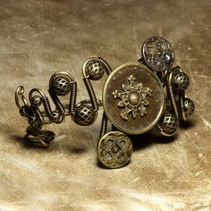 Steampunk Jewelry - BRACELET - Vintage buttons BRASS Copper and antiqued metal beads - OOAK by Catherinette Rings Steampunk, via Flickr
