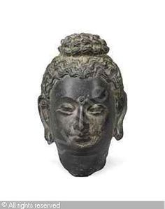 Image from http://www.artvalue.com/photos/auction/0/52/52730/gandhara-2nd-3rd-afghanistan-a-head-of-buddha-3277230-500-500-3277230.jpg.